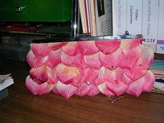 Cheap bag covered with hand sewn flower petals