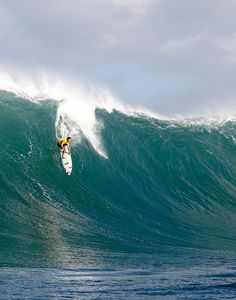 I'd love to learn how to surf. And not east coast style where the wave is only 2 inches high. I mean like in this photo.
