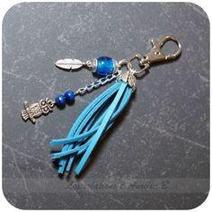 Aurélia B - Bijou de sac bleu breloques hibou et plume