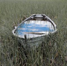 ~Such an awesome photo of the sky reflected in the water in the boat.