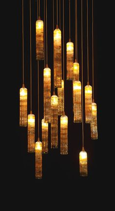 This looks like lit candles hanging by strings!