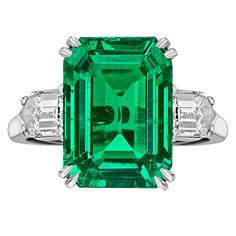 Van Cleef & Arpels Colombian Emerald-Cut Emerald & Diamond Ring Colombian, emerald-cut emerald ring in platinum with fancy-cut diamond shoulders, the emerald weighing carats and two diamonds weighing total carats, numbered signed Van Cleef & Arpels. Van Cleef Arpels, Van Cleef And Arpels Jewelry, Colombian Emerald Ring, Emerald Diamond, Diamond Cuts, Emerald Cut, Natural Emerald, Emerald Green, Emerald Stone