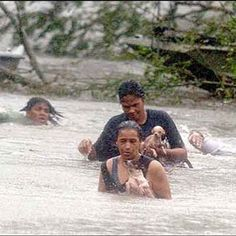 A family is seen trying to escape the wrath of Hurricane Katrina in the days it wreaked havoc in New Orleans.