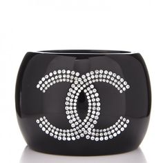 CHANEL Resin Crystal CC Cuff Bracelet Black #mariskelately #apparel #shopping #luxliving #luxuryshopping #onlinestore #beauty #health #makeup #bags #fitness #style #uniquestyle #fashion #fashionistas #fashionphile #jewlry #luxuryliving #luxuryjewelry #makeastatement #refinedlife #chanel #chaneljewlry #chanelgirl Fitness Style, Shop Till You Drop, Makeup Bags, Luxury Jewelry, Jewelery, Resin, Chanel, Crystals, Bracelets