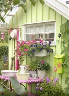 I love the colour of this little garden building as well as the use of a window box and the decor :)