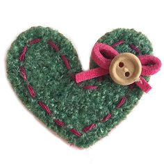 YOU CAN'T GO WRONG WITH AN ADORABLE HEART. HAND STITCHED WITH A TINY SIGNATURE WOODEN BUTTON & FUCHSIA BOW ROSA IS FASHIONED FROM SOFT & TACTILE FELT AND FASTENS WITH A SINGLE BAR CLIP AT THE BACK. Button Jewellery, Aw17, Winter Season, Hand Stitching, Happy Shopping, Felt, Bows, Buttons, Christmas Ornaments
