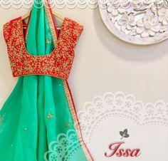 SC-S250: Red and sea green saree with hand embroidery!!!!Issa Studio can customize the colour   size as per your requirement.To order please call/ WhatsApp on 9949944178 or mail us @issadesignerstudio@gmail.com  21 March 2017