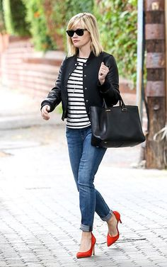 Shop this look for $116:  http://lookastic.com/women/looks/varsity-jacket-and-crew-neck-t-shirt-and-shopper-handbag-and-jeans-and-heels/1822  — Black Varsity Jacket  — White and Black Horizontal Striped Crew-neck T-shirt  — Black Leather Tote Bag  — Blue Jeans  — Red Suede Pumps