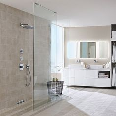 Floor-level shower bathroom trend | Hansgrohe US - The shower heads are what I like and are placed on the long wall. Can we do a drain like this? Too expensive?  Seems clean and seamless.
