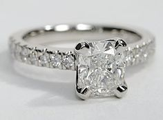 Classic in design, this diamond engagement ring setting features round diamonds set in platinum and a beautifully tapered four-prong head for your center diamond. Setting includes 1/3 carat total diamond weight.