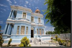 A photograph of Palacio Azul hotel in Cienfuegos    Keywords: Stock Photo Picture Cuba Cuban Spanish Speaking Countries Latin America Cienfuegos Horizontal Blue Daytime Sunny Architectural Travel Photos Wide Angle Building Hotel Palacio Azul Tourist Attractions Architecture