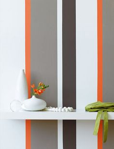 orange, white, grey vertically striped wall