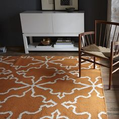 Love this orange rug...look great in a gray room!