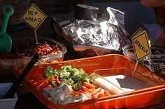 What a clever idea!  Using orange paint trays for the food.  Love the little signs too.