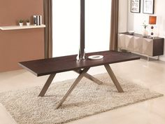 J&M Nova Dining Table - This dining table is out of this world. Extremely spacious, at 94.5 inches long, comfortably sitting up to 10.  This  edgy design will take your breath away, with taupe high gloss legs, uniquely designed for stability and style.  Dimensions: 94.5 L x 39.5 W x 30 H