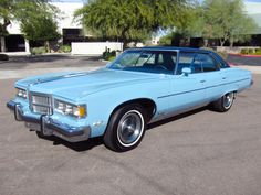 1975 Pontiac Grand Ville. GM full size cars were at the peak of their boat-like girth in the mid seventies. In 1977, all big cars at GM would be drastically downsized.