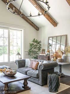 By being selective in the colors I displayed it brought a cohesive look to my living room and is a reflection of what I love. Try this simple idea for fall decorating and see how it transforms your home!