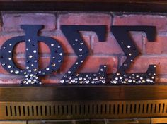 Phi Sig letters. Cut out from foam poster board then painted, much cheaper than wooden greek letters!