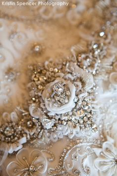 Engagement ring in crystal wedding gown ~ Kristen Spencer Photography
