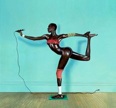 Classic pic of Grace Jones.  The pic is a composite, lonnnggg before photoshop.  Here's the backstory: http://iconicphotos.wordpress.com/2010/06/14/grace-jones/