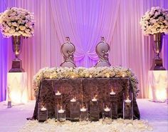 What beautiful pipe and drape set up behind this amazing sweetheart table. Photo via #Platinumelegance