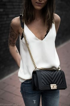 d4606a7ff Brunette wearing a white silk cami from Grana with a distressed blue denim  from H&M and