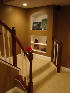 I like this idea for the bottom of the basement stairs. Both the built in shelves and the turn at the bottom.