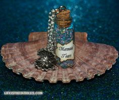 Mermaid Tears Magical Bottle with a Sea Shell Charm Disney Pirates of the Caribbean Stranger Tides by Life is the Bubbles. $15.00, via Etsy.