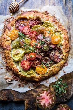If you are lucky enough to find heirloom tomatoes at your local farmers market, make this Heirloom Tomato Galette with Honey + Thyme from Half Baked Harves.