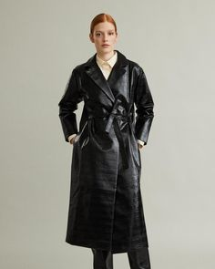 Mira is a statement trench featuring a classic collar and a belted waist. This shiny lacquer coat is the perfect piece to make layering effortless, yet bold. The style features pockets on both sides, and a luxurious black and white checked inside. Designing Women, Trench, Blues, Raincoat, Black And White, Apothecary, Layering, Cotton, Jackets