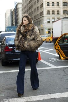 A fantastic fur coat, textured, and sable foils great with a dark boot cut, extra long jean. The deep hem of the jean causes the casualness of the denim to be brought up a notch. Pairs excellently with the length of the coat.