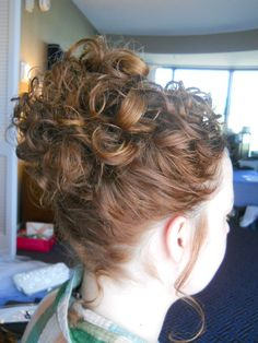 Wedding hair - Soft Sophisticated bride or bridesmaid updo with naturally curly hair styled by Carrie at Appease Inc. Need a stylist for your wedding? We travel anywhere!  See our website at www.appease2you.com for details.