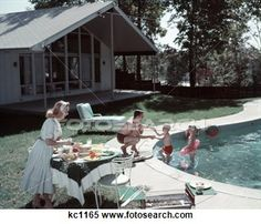 Family Of 4 Backyard Swimming Pool House Mom Serving Food Meal At Table By Grill Dad Boy Girl Summer Lawn Furniture Stock Photography Ny Times, Good Times, California Architecture, Lawn Furniture, Family Of 4, Swimming Pools Backyard, Always Learning, Summer Girls, Beautiful Images