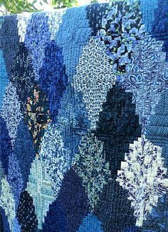 Shades of blue log cabin quilt.