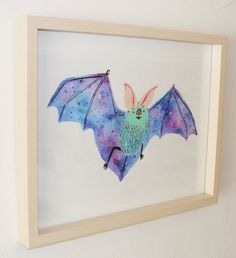 This is the perfect print for any bat (or space) lover in your life! This print features a colorful bat with space wings. Hed love to hang out anywhere in your house! This reproduction of the original gouache painting is professionally printed in the USA on an 8 x 10 or 11 x 14 piece of sturdy watercolor paper. It will fit into any standard 8 x 10 or 11 x 14 frame of your choosing.  All Cactus Club prints come signed and are packaged and protected in a plastic sleeve with backing board…