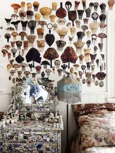 collection of tortoiseshell hair combs hung on wall with pottery shard encrusted vanity below: Greg Irvine — The Design Files | Australia's most popular design blog.