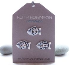 Fishy buttons by RuthRobinsonCeramics, England (etsy) Handmade porcelain.