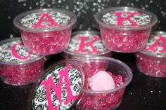 spa party foot soak - I think this is placed in simple plastic containers. Cheap yet effective. Each girl's initial is placed on top.