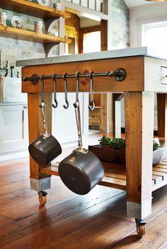 Custom pine kitchen island with pot rack and zinc countertop.