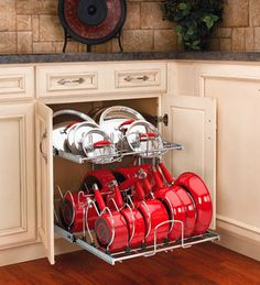 The website Kitchens.com has pictures of a truly beautiful pot and pan organizing system by Rev-a-Shelf: