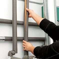 Insulate Pipes Before Boxing Them In - While they're exposed, slip foam insulation sleeves over hot-water pipes to prevent heat loss and over cold-water ones to prevent condensation from dripping on the inside of the drywall or ceiling.
