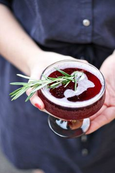 Holiday Drink with a garnish of rosemary. #savourthemoment