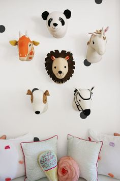 Next time you're looking to dress up an empty wall, think outside the frame. A wall filled with playful stuffed animal heads, a cool collection of old oars or even vintage plates are all fresh takes on the traditional gallery wall. Artwork doesn't have to be confined by a frame, but it will create an awesome focal point for a room. Click through for more adult-friendly kids room decor ideas.