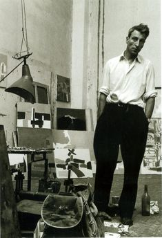 Nicolas de Staël (1914-1955) in 1954 surrounded by his works in his studio, Gauguet street in Paris in the summer of 1954. Photographed by Denise Colomb.