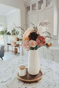 Create a stunning centerpiece for your tablescape, or a simple arrangement for your kitchen island. Choose high-quality faux flowers from Afloral.com to recreate this look. Shop artificial flowers and greenery for your home decor at Afloral.com.