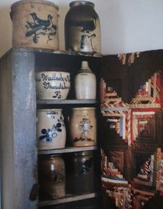 Old Cupboard...prim salt glazed crocks & quilt.