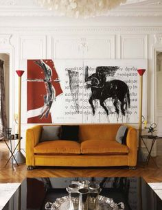Vintage gold corduroy sofa with oversized dramatic wall art.