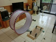 Cat wheel - the site isn't in english, but the picture shows the simple design for a cat wheel.