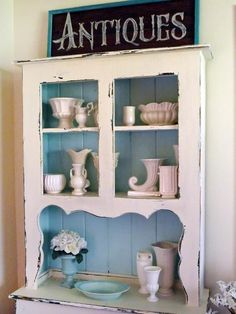 Kitchen Cabinet, 3-corner cabinet, antiqued, white vases - 16 Distressed Furniture Pieces You'll Want In Your Home on HGTV