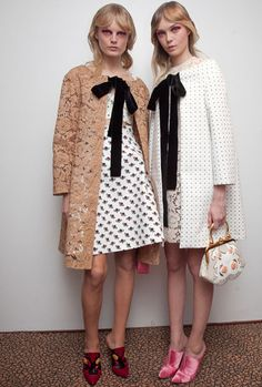 Mui Mui ss2012-- ignore the model's creepy eyes, but I love these coats. I would love to find one that would look good if I attached black ribbon like this.